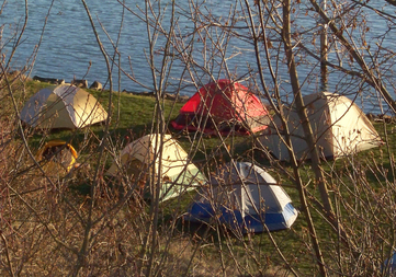 Tents next to lake in City of Harrison campground